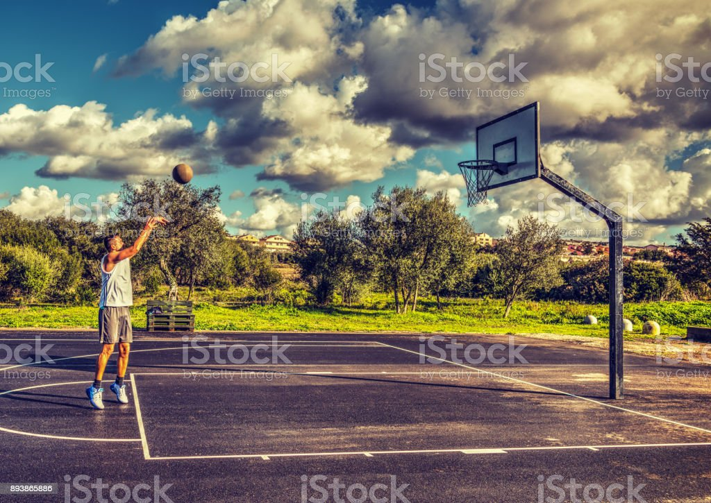 Lefty basketball player practicing free throws stock photo