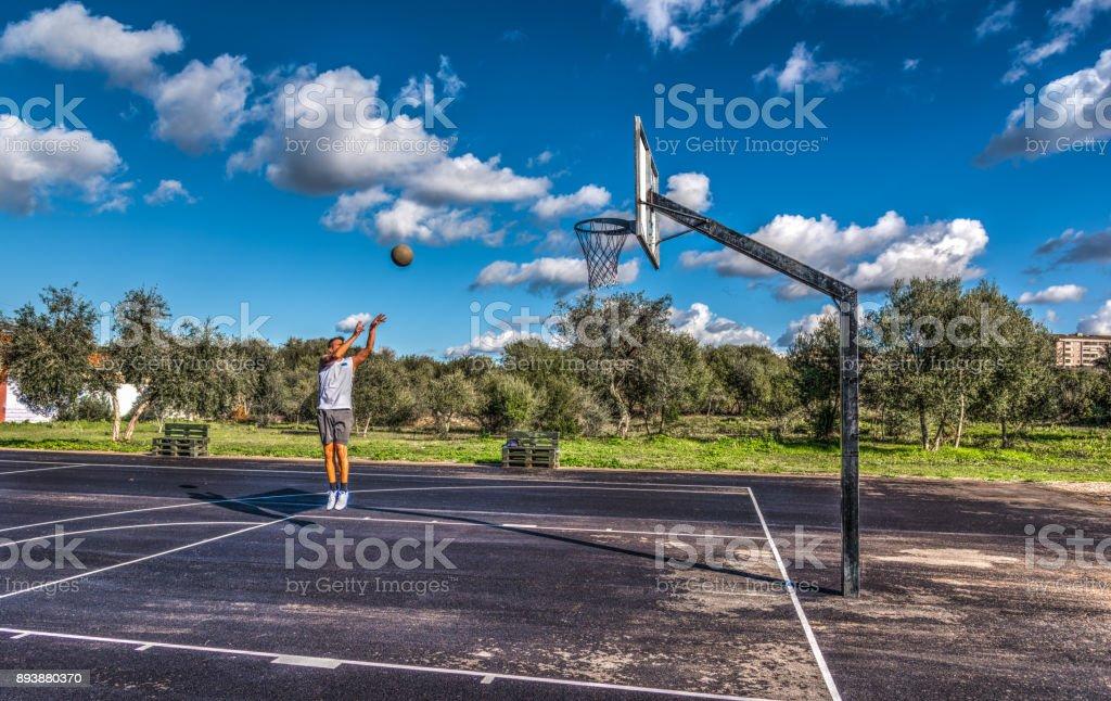 Lefty basketball player practicing jump shot stock photo