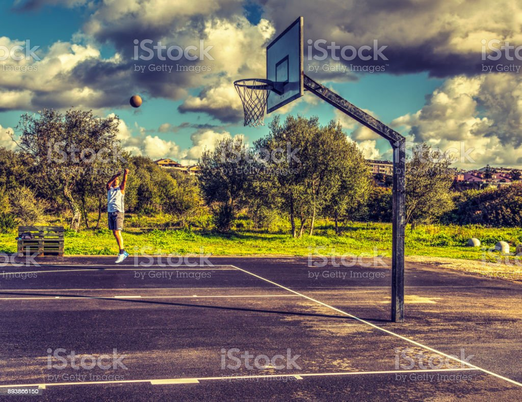 Lefty three point shot from the corner stock photo
