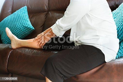 698466046 istock photo leg cramp, senior woman suffering from leg cramp pain at home, health problem concept 1126430505