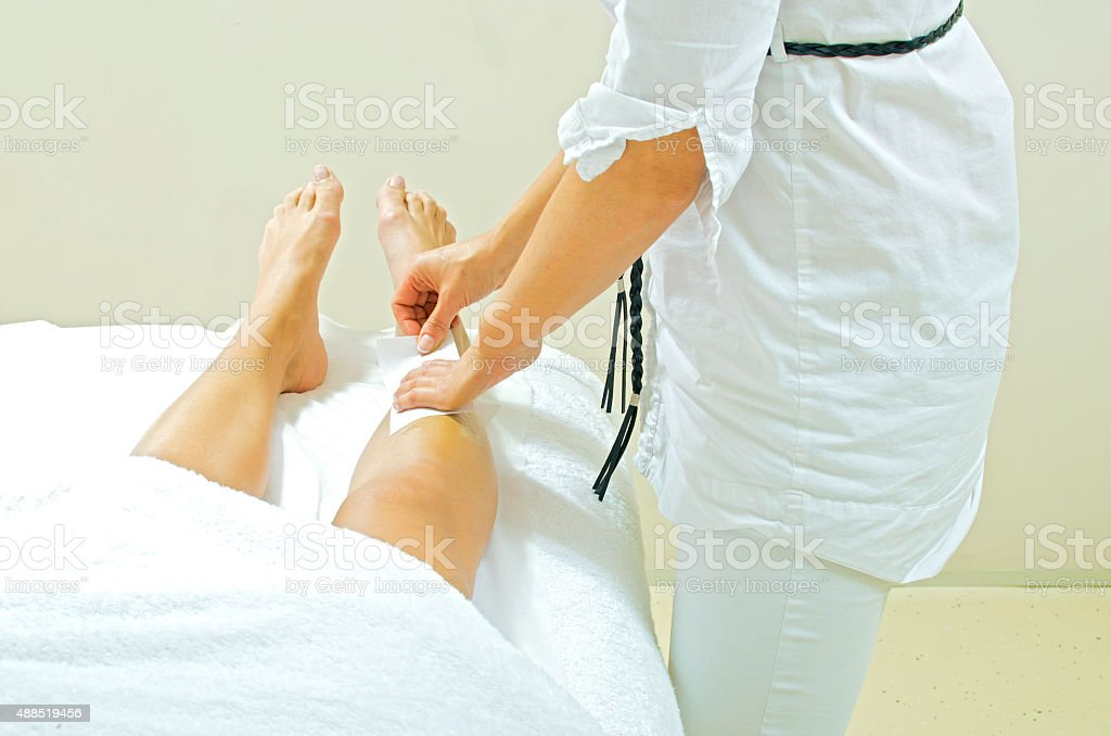 Leg depilation stock photo