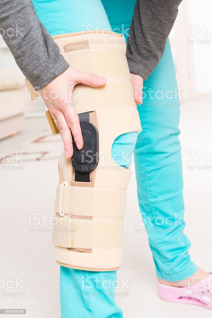 Leg in knee cages stock photo
