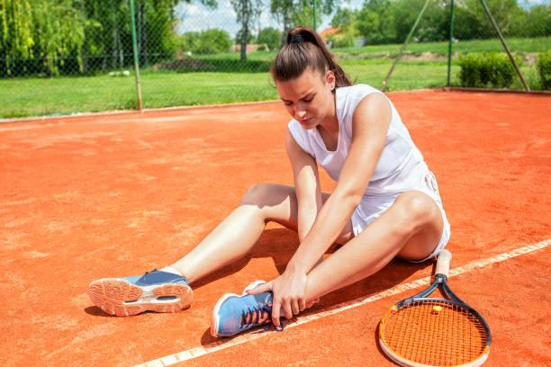 Leg injury on the tennis court stock photo