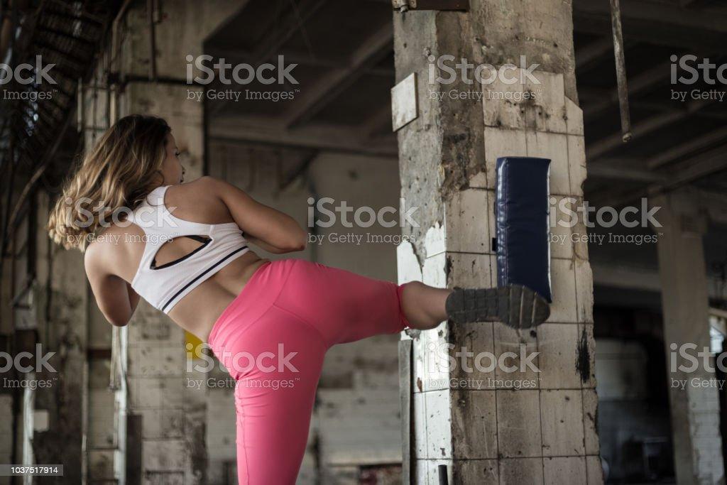 Leg kick by a female athlete stock photo