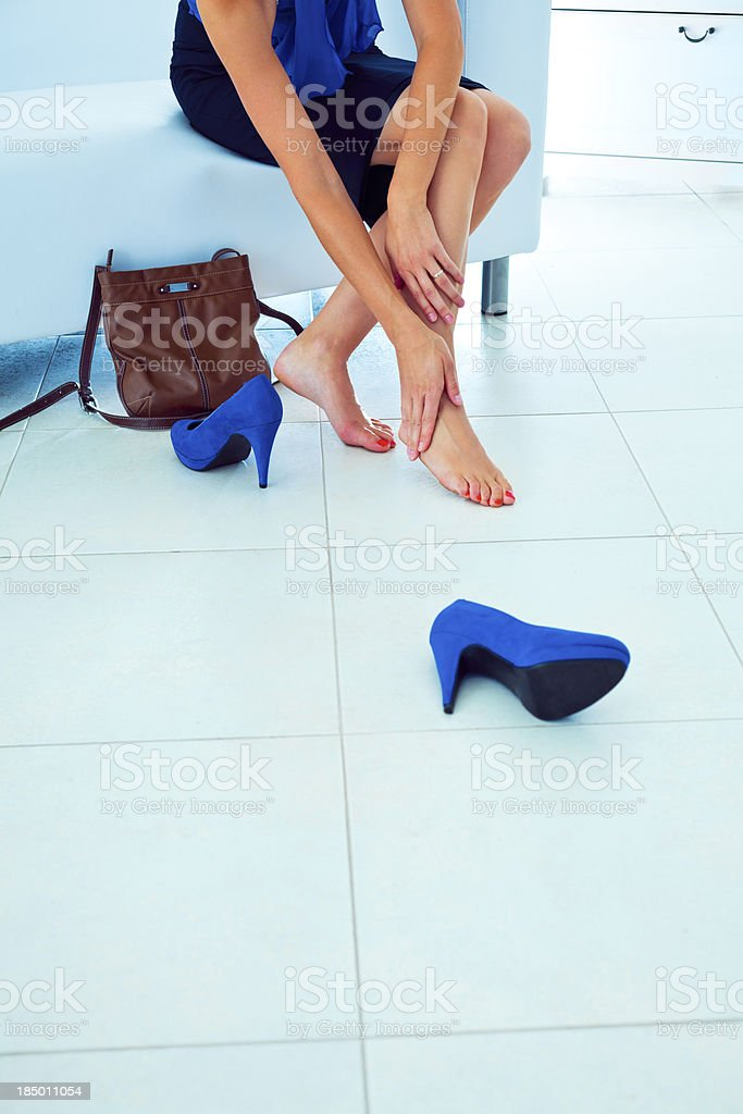 Leg massaging stock photo