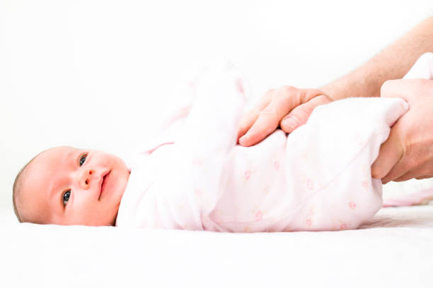 leg movements for the baby suffering gas pains stock photo