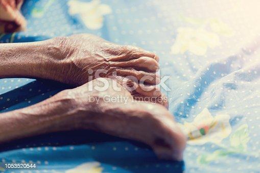 Leg of old woman sleep in bed. Wrinkles of old woman skin.