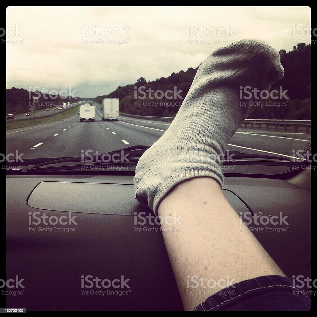 Leg On the Dashboard stock photo