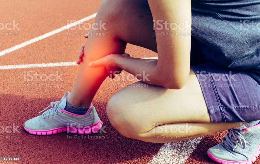 Leg pain from exercise - Healthcare And Medicine - Physical Injury - Photographic Effects stock photo