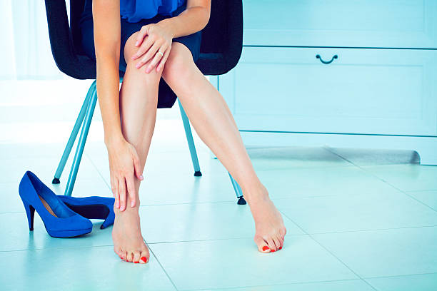 Dolor de la pierna - foto de stock