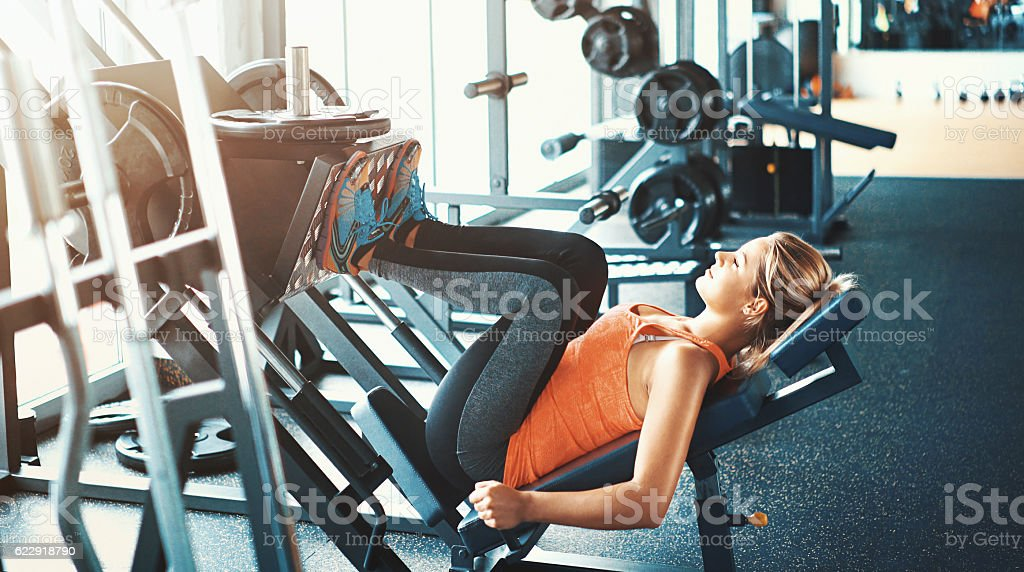 Leg press exercise. stock photo