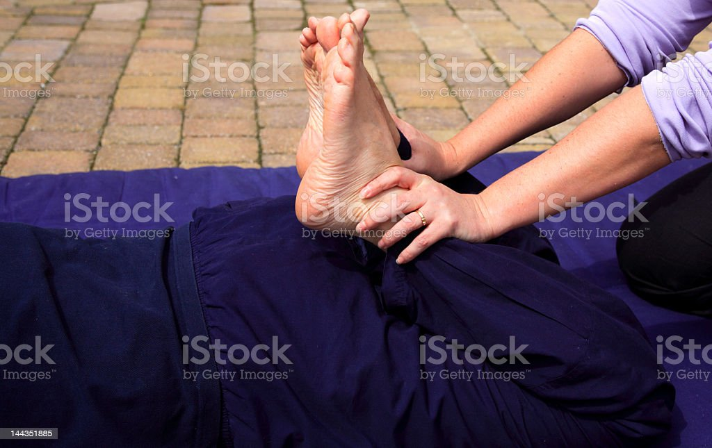 Leg stretch as part of a traditional Thai massage royalty-free stock photo