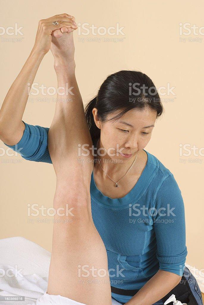 Leg Stretch  - Sports Massage Series royalty-free stock photo