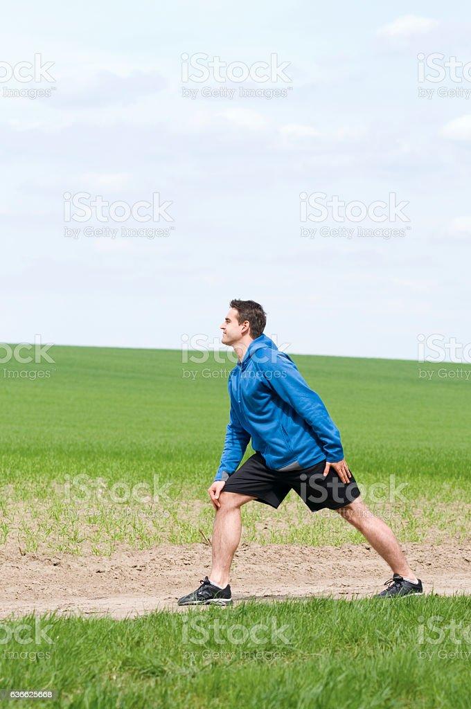 leg stretching backwards stock photo