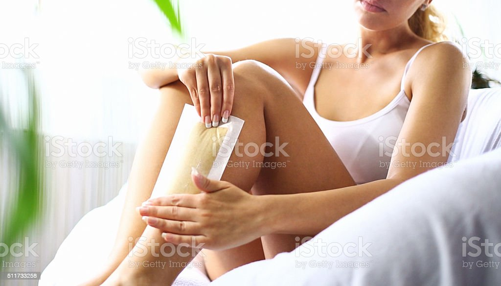 Leg waxing at home. stock photo