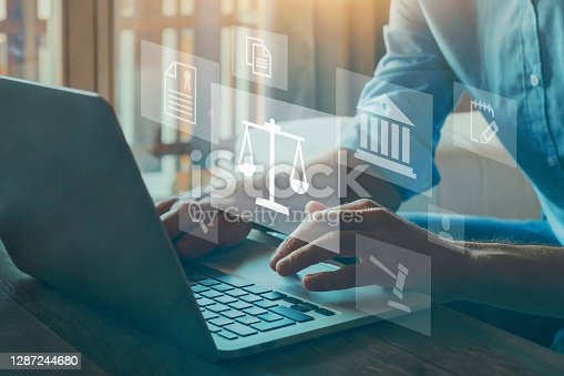 istock Legal advice online, labor law concept, layer or notary working. 1287244680