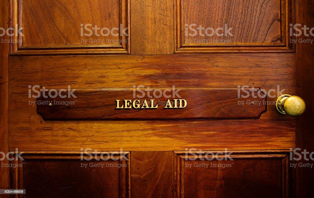 Legal aid sign on door stock photo