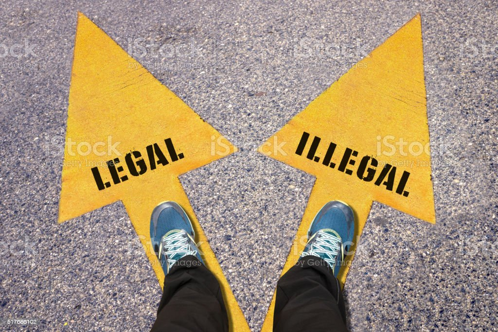 Legal and Illegal painted on road stock photo