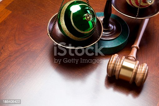 Gavel and scales of justice with Christmas ornaments