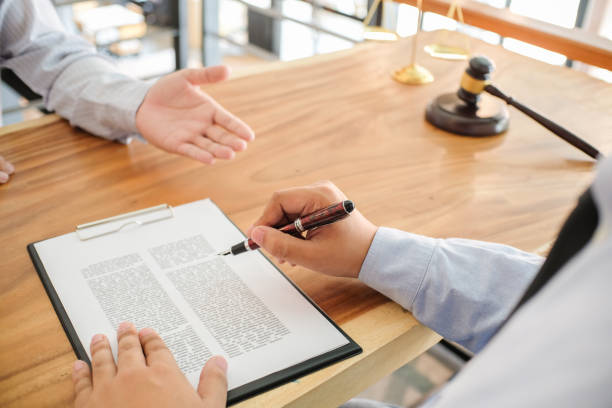 legal counsel presents to the client a signed contract with gavel and legal law. justice and lawyer concept . - real estate law stock photos and pictures