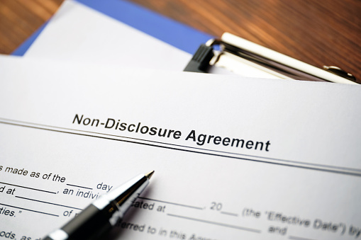 Legal document Non-Disclosure Agreement on paper close up