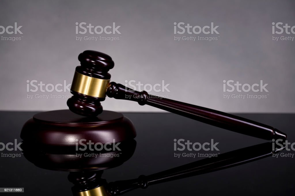 Legal hammer on the table. stock photo