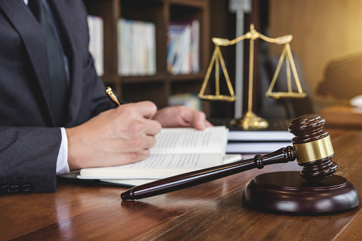 istock Legal law, advice and justice concept, Judge gavel with Justice lawyers, Counselor in suit or lawyer working on a documents in courtroom 1066273144