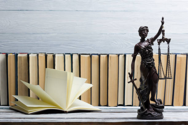 legal law concept - open law book with a wooden judges gavel on table in a courtroom or law enforcement office. copy space for text - practice stock pictures, royalty-free photos & images