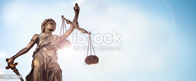 istock Legal law concept statue of Lady Justice with scales of justice sky background 1207748593
