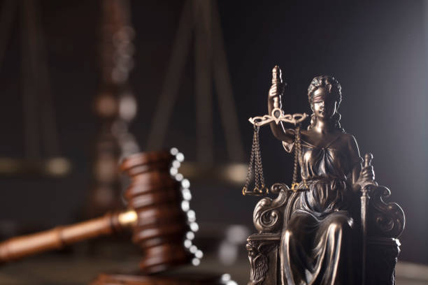 Legal office concept. Themis, gavel and scale on wooden desk. lawyer stock pictures, royalty-free photos & images