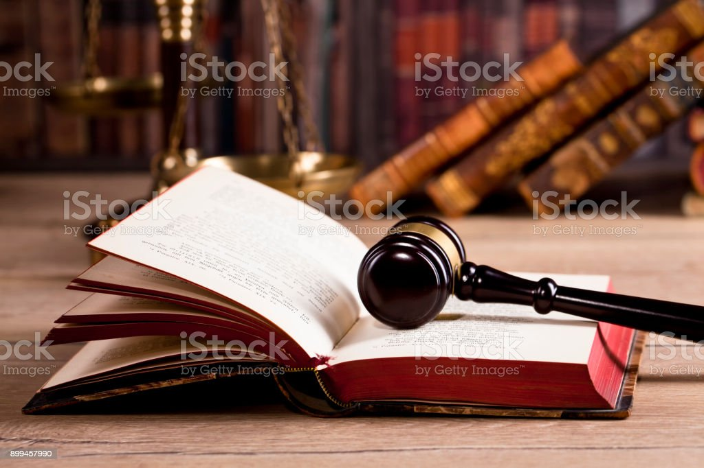 Legal office, lawbooks and  wooden judge's gavel Law concept stock photo