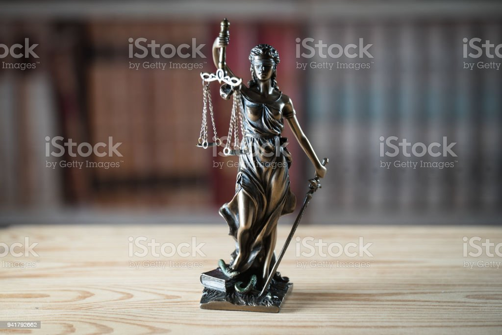 Legal office of lawyer. legal model statue of Themis goddess of justice. stock photo