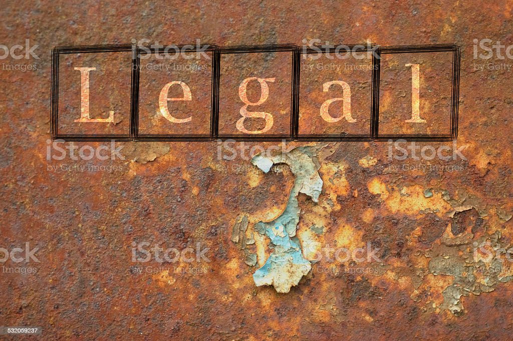 legal written on a wall background stock photo