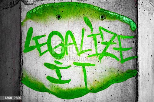 136699912 istock photo Legalize It Graffiti Below Bridge 1159912399