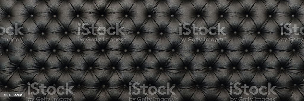 legant black leather texture with buttons for pattern and background stock photo
