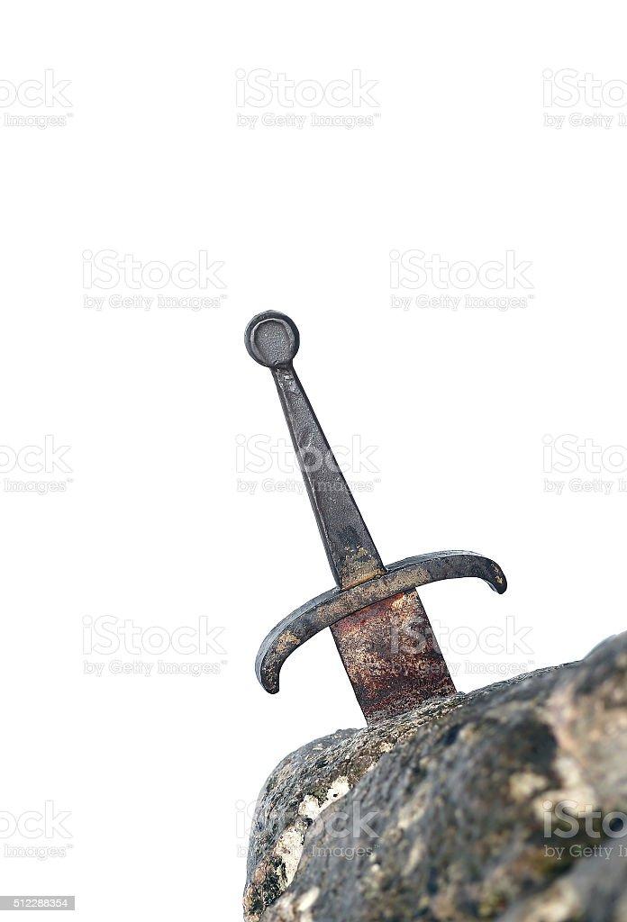 legendary Excalibur sword into the stone stock photo