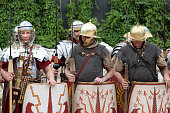 Moscow, Russia - June 16, 2019: Men reenactors dressed as legionaries of Ancient Rome standing on Pokrovsky Boulevard during Moscow historical festival Times and epochs. Reconstruction of armor and weapons of Roman army on Moscow streets