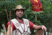 Moscow, Russia - June 16, 2019: Male reenactor dressed as legionary of Ancient Rome posing on Pokrovsky Boulevard during Moscow historical festival Times and epochs. Reconstruction of armor and weapons of Roman army on Moscow streets