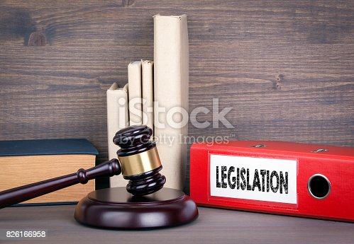 826166958 istock photo Legislation. Wooden gavel and books in background. Law and justice concept 826166958