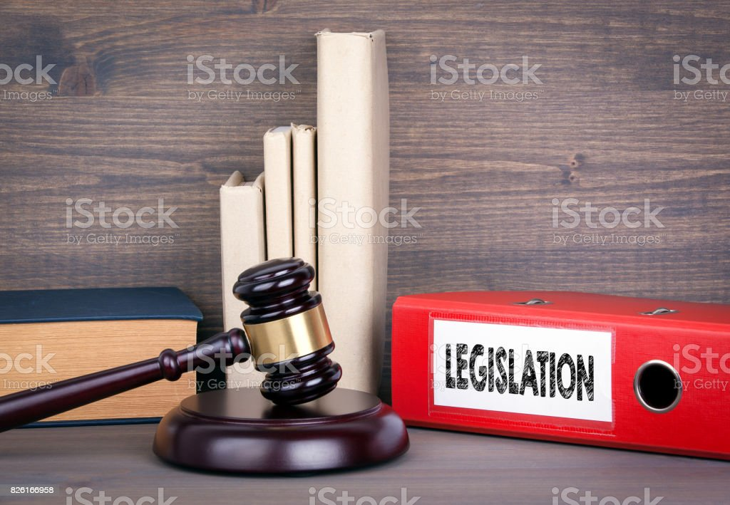 Legislation. Wooden gavel and books in background. Law and justice concept stock photo