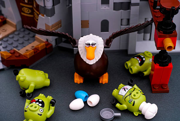 Lego Angry Birds. Four Bad piggies defeated by Mighty Eagle stock photo