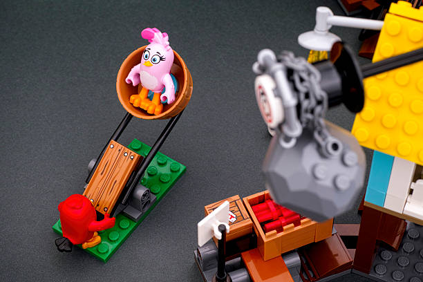 Lego Angry Birds Red and Stella using catapult stock photo