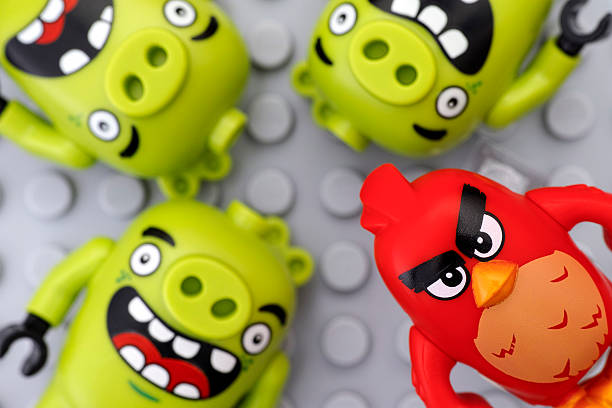 Lego Angry Birds. Red and three bad piggies stock photo