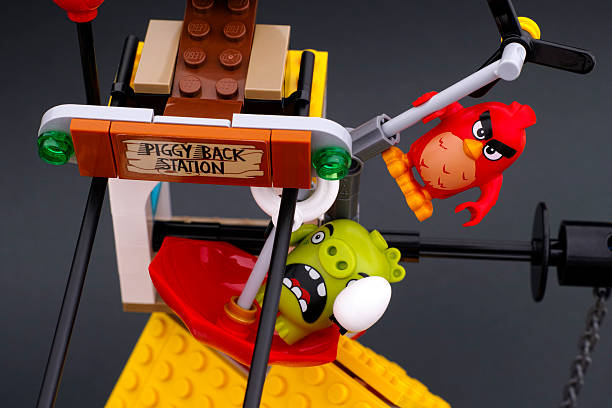 Lego Angry Birds. Red bird chasing piggy stock photo