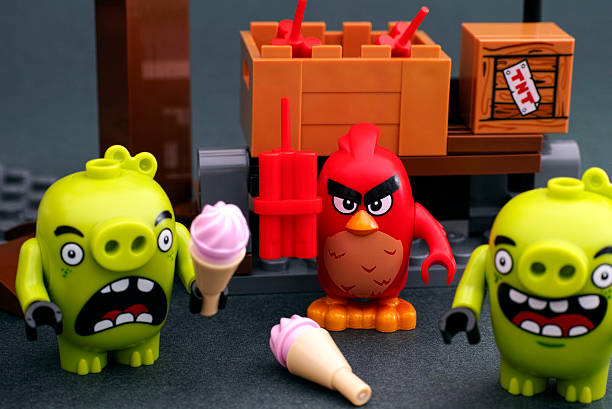 Lego Angry Birds. Red bird with dynamite and bad piggies stock photo