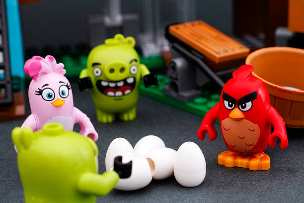 Lego Angry Birds. Red, Stella and 2 piggies. stock photo