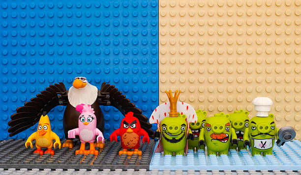 Lego Angry Birds versus Bad Piggies stock photo
