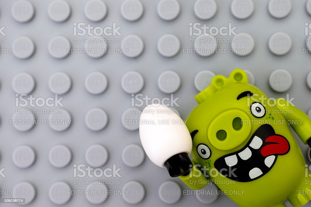 Lego Bad piggy with egg on gray baseplate royalty-free stock photo