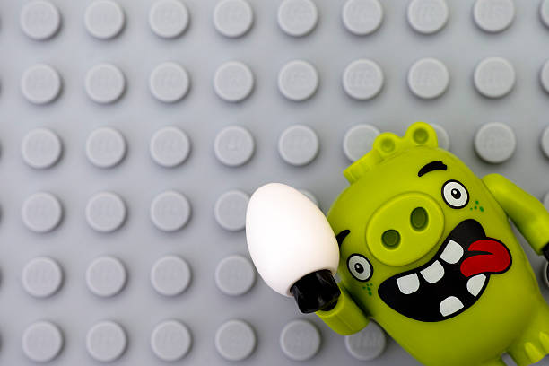 Lego Bad piggy with egg on gray baseplate stock photo
