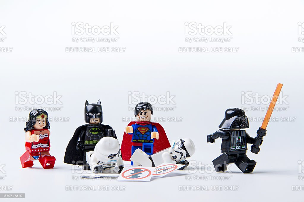 Lego Batman and Superman expel lego Stormtrooper and darth vader stock photo